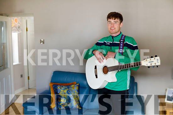 """Craig Counihan from Castlemaine, on the guitar for the """"Stars in the Livingroom"""" fundraiser for Milltown/Castlemaine GAA Club."""