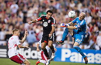 Dwayne De Rosario (7) of D.C. United scores with a header over Bill Gaudette (88) of the New York Red Bulls during the game at RFK Stadium in Washington, DC.  D.C. United tied the New York Red Bulls, 2-2.  De Rosario has now scored 100 goals in his regular season career.