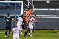 SAN JOSE, CA - OCTOBER 28: San Jose Earthquakes goalkeeper JT Marcinkowski #18 punches the ball clear during a game between Real Salt Lake and San Jose Earthquakes at Earthquakes Stadium on October 28, 2020 in San Jose, California.