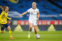 SOLNA, SWEDEN - APRIL 10: Lindsey Horan #9 of the United States looking for an open man during a game between Sweden and USWNT at Friends Arena on April 10, 2021 in Solna, Sweden.