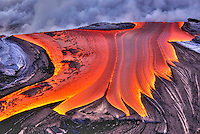 Lava flows into the Pacific ocean at Hawai'i Volcanoes National Park on the Big Island.