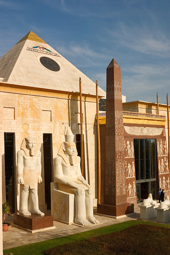 Dubai. United Arab Emirates.  Entrance to the Pyramids restaurant complex with statues, obelisk and pyramid at the Wafi Centre/Center.
