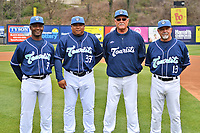 Asheville Tourists coaching staff (L-R) Paco Martin (7), Robinson Cancel (37), Randy Ingle (12) and Mark Brewer (13) during media day at McCormick Field on April 2, 2019 in Asheville, North Carolina. (Tony Farlow/Four Seam Images)