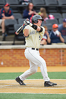 Ben Breazeale (9) of the Wake Forest Demon Deacons follows through on his swing against the Virginia Cavaliers at Wake Forest Baseball Park on May 17, 2014 in Winston-Salem, North Carolina.  The Demon Deacons defeated the Cavaliers 4-3.  (Brian Westerholt/Four Seam Images)