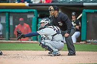 John Baker (24) of the Tacoma Rainiers with home plate umpire Chris Gonzalez in action against the Salt Lake Bees in Pacific Coast League action at Smith's Ballpark on May 7, 2015 in Salt Lake City, Utah.  (Stephen Smith/Four Seam Images)