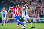 Yannick Ferreira Carrasco (l) of Atletico de Madrid is challenged by Esteban Felix Granero Molina of Real Sociedad during their La Liga match between Atletico de Madrid vs Real Sociedad at the Vicente Calderon Stadium on 04 April 2017 in Madrid, Spain. Photo by Diego Gonzalez Souto / Power Sport Images