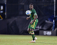 LAKE BUENA VISTA, FL - JULY 18: Larrys Mabiala #33 of the Portland Timbers follows the ball during a game between Houston Dynamo and Portland Timbers at ESPN Wide World of Sports on July 18, 2020 in Lake Buena Vista, Florida.