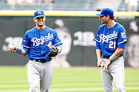 Kansas City Royals outfielder Jeff Franceur #21 talks with Alex Gordon #4 before a game against the Chicago White Sox at U.S. Cellular Field on August 14, 2011 in Chicago, Illinois.  Chicago defeated Kansas City 6-2.  (Mike Janes/Four Seam Images)