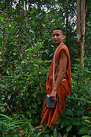 "A very bizarre site a Monk with his cell Phone in the middle of the Jungle on the way to Phom Kulen, ""Elephant Park"" and Bat Caves, Cambodia"