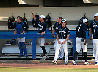 IMG Academy Ascenders bench (L-R) Brady Neal (catcher), Max Galvin (17), Drew Gray (15), and Evan Clark (7) celebrate during a game against the Jesuit Tigers on April 21, 2021 at IMG Academy in Bradenton, Florida.  (Mike Janes/Four Seam Images)