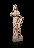 Roman statue of women. Perge. 2nd century AD. inv 3270 . Antalya Archaeology Museum; Turkey. Against a black background.