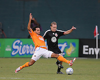 Houston Dynamo forward Dwayne De Rosario (14) tries to stop the pass from DC United defender Bryan Namoff (26) ,The Houston Dynamo defeated DC United 3-1 to secure their place in  the SuperLiga semifinals, at RFK Stadium in Washington DC, Saturday July 19, 2008.