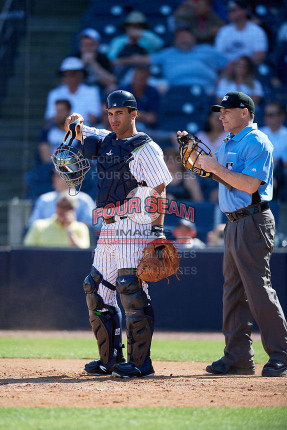 New York Yankees catcher Jorge Saez (80) and home plate umpire Dan Iassogna during a Grapefruit League Spring Training game against the Toronto Blue Jays on February 25, 2019 at George M. Steinbrenner Field in Tampa, Florida.  Yankees defeated the Blue Jays 3-0.  (Mike Janes/Four Seam Images)