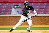 Steven Brooks #1 of the Wake Forest Demon Deacons lays down a bunt in the bottom of the 9th inning against the Miami Hurricanes at Gene Hooks Field on March 19, 2011 in Winston-Salem, North Carolina.  The Hurricanes defeated the Demon Deacons 4-3.  Photo by Brian Westerholt / Four Seam Images