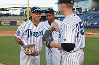 Tampa Tarpons right fielder Omar Carrizales (left) hands the final out ball to pitcher Trevor Stephan (35) after a Florida State League game against the Jupiter Hammerheads on July 26, 2019 at George M. Steinbrenner Field in Tampa, Florida.  Stephan struck out 9 batters over 7 innings for a no-hitter in the first game of a doubleheader.  Tampa defeated Jupiter 2-0.  (Mike Janes/Four Seam Images)