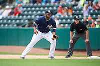 Columbus Clippers first baseman Jesus Aguilar (30) in position as umpire John Bacon looks on during a game against the Lehigh Valley IronPigs on May 12, 2016 at Huntington Park in Columbus, Ohio.  Lehigh Valley defeated Columbus 2-1.  (Mike Janes/Four Seam Images)