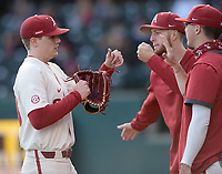 Arkansas reliever Elijah Trest (left) is congratulated by teammates Wednesday, April 7, 2021, after the final out of the top of the sixth inning of the Razorbacks' 10-3 win over UALR at Baum-Walker Stadium in Fayetteville. Visit nwaonline.com/210408Daily/ for today's photo gallery. <br /> (NWA Democrat-Gazette/Andy Shupe)