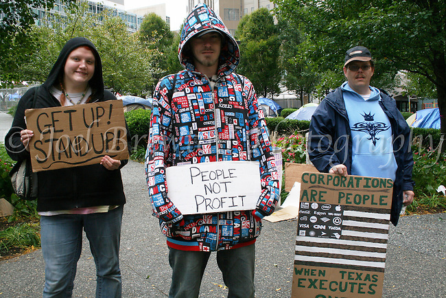 """Bailey, Robbie and Dan (left to right) arrived that very morning for their first day of protesting. """"The rich are getting richer, the poor are getting poorer and it's time for our generation to do something about it,"""" said Robbie."""