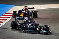 28th March 2021; Sakhir, Bahrain; F1 Grand Prix of Bahrain, Race Day;   44 HAMILTON Lewis gbr, Mercedes AMG F1 GP W12 E Performance ahead of 33 VERSTAPPEN Max nld, Red Bull Racing Honda RB16B during the last laps of the Formula 1 Gulf Air Bahrain Grand Prix 2021
