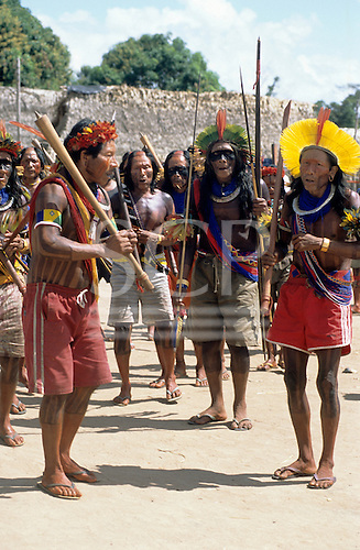 Bacaja village, Amazon, Brazil. Elder dancing with artifacts, during the hornets' nest initiation ceremony; Xicrin tribe.
