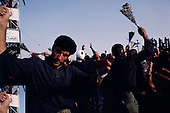 """Tehran, Iran .June 9, 1989..Hundreds of thousands of mourners visit the grave site for the Grand Ayatullah Sayid Ruhullah Musawi Khomeini in the Beheht-E-Zahra cemetery. Certain groups flagellate themselves before the tomb and mothers have soldiers guarding the tomb, touch their baby's to the grave wall's as a blessing. He died of heart attack on June 3, 1989...Khomeini was a senior Shi`i Muslim cleric, Islamic philosopher and marja (religious authority), and the political leader of the 1979 Iranian Revolution that saw the overthrow of Mohammad Reza Pahlavi, the last Shah of Iran. Following the revolution, Khomeini became the country's Supreme Leader?the paramount political figure of the new Islamic Republic...Khomeini was a marja al-taqlid, (source of imitation) and important spiritual leader to many Shia Muslims. He was also an innovative Islamic political theorist, most noted for his development of the theory of velayat-e faqih, the """"guardianship of the jurisconsult (clerical authority)"""". He was named Time's Man of the Year in 1979 and also one of Time magazine's 100 most influential people of the 20th century."""
