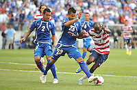 DaMarcus Beasley (7) of the USMNT goes against Mardoqueo Henriquez (23) of El Salvador.  The USMNT defeated El Salvador 5-1 at the quaterfinal game of the Concacaf Gold Cup, M&T Stadium, Sunday July 21 , 2013.
