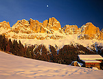 Italy, South Tyrol, Dolomites: Alpenglow (last sunset light) at Cima Catinaccio mountain range (2.981 m) and the moon
