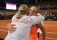 Februari 07, 2015, Apeldoorn, Omnisport, Fed Cup, Netherlands-Slovakia, Arantxa Rus (NED) defeates  Magdaléna Rybáriková (SLO) and falls into the arms of Michaella Krajicek<br /> Photo: Tennisimages/Henk Koster