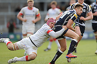 20130310 Copyright onEdition 2013©.Free for editorial use image, please credit: onEdition..Charlie Ingall of Sale Sharks is tackled by Nick Fenton-Wells of Saracens during the LV= Cup semi final match between Sale Sharks and Saracens at the Salford City Stadium on Sunday 10th March 2013 (Photo by Rob Munro)..For press contacts contact: Sam Feasey at brandRapport on M: +44 (0)7717 757114 E: SFeasey@brand-rapport.com..If you require a higher resolution image or you have any other onEdition photographic enquiries, please contact onEdition on 0845 900 2 900 or email info@onEdition.com.This image is copyright onEdition 2013©..This image has been supplied by onEdition and must be credited onEdition. The author is asserting his full Moral rights in relation to the publication of this image. Rights for onward transmission of any image or file is not granted or implied. Changing or deleting Copyright information is illegal as specified in the Copyright, Design and Patents Act 1988. If you are in any way unsure of your right to publish this image please contact onEdition on 0845 900 2 900 or email info@onEdition.com
