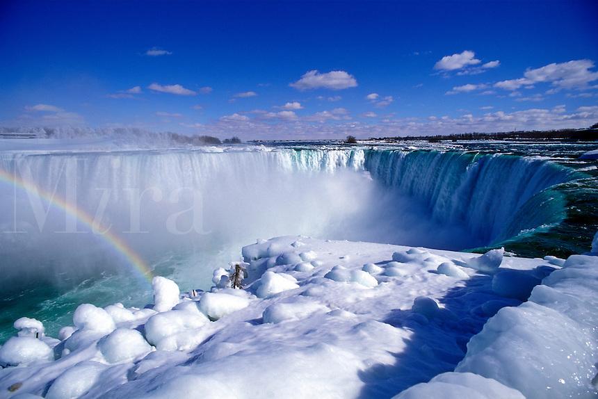 Canada, Ontario, Niagara Falls, Horseshoe Falls in winter with rainbow