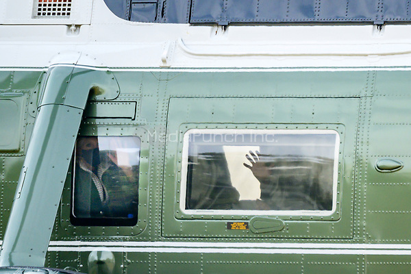 United States President Joe Biden and first lady Jill Biden wave from Marine One in Washington, D.C., U.S., on Friday, Feb. 26, 2021. Biden is visiting Texas today to discuss recovery efforts after winter weather caused widespread damage and left millions without power. <br /> Credit: Erin Scott / Pool via CNP /MediaPunch