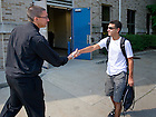 Aug. 19, 2011; Rev. Pete McCormick, C.S.C., rector of Keough Hall, greets an incoming first year resident during move-in 2011...Photo by Matt Cashore/University of Notre Dame