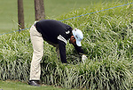 SUZHOU, CHINA - APRIL 15:  Pablo Larrazabal of Spain looks for a lost ball on the 18th hole during the Round One of the Volvo China Open on April 15, 2010 in Suzhou, China. Photo by Victor Fraile / The Power of Sport Images