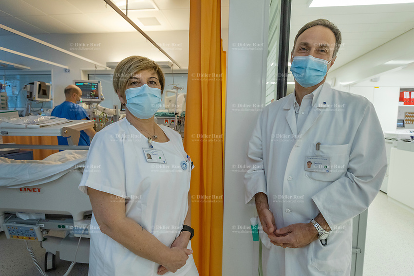 Switzerland. Canton Ticino. Lugano. Civico hospital (EOC Ospedale Regionale di Lugano - Civico). Intensive care medicine. The chief nurse at Civico Hospital, Giovanna Pezzolini (L), talks to Prof. Dr. Med Paolo Merlani (R). Prof. Dr. Med Paolo Merlani is the director of the intensive care units (ICUs) (Primario Medicina intensive, Diretore medico Dipartimento Area Critica ORL e Direttore  sanitorio ORL). Prof. Dr. Med Paolo Merlani has the same functions on a cantonal level. Intensive care medicine, also called critical care medicine, is a medical specialty that deals with seriously or critically ill patients who have, are at risk of, or are recovering from conditions that may be life-threatening. It includes providing life support, invasive monitoring techniques, resuscitation, and end-of-life care. Doctors in this specialty are often called intensive care physicians, critical care physicians or intensivists. Intensive care relies on multidisciplinary teams composed of many different health professionals. Such teams often include doctors, nurses, physical therapists, respiratory therapists, and pharmacists, among others. They usually work together in intensive care units (ICUs) within a hospital. 20.11.2020 © 2020 Didier Ruef