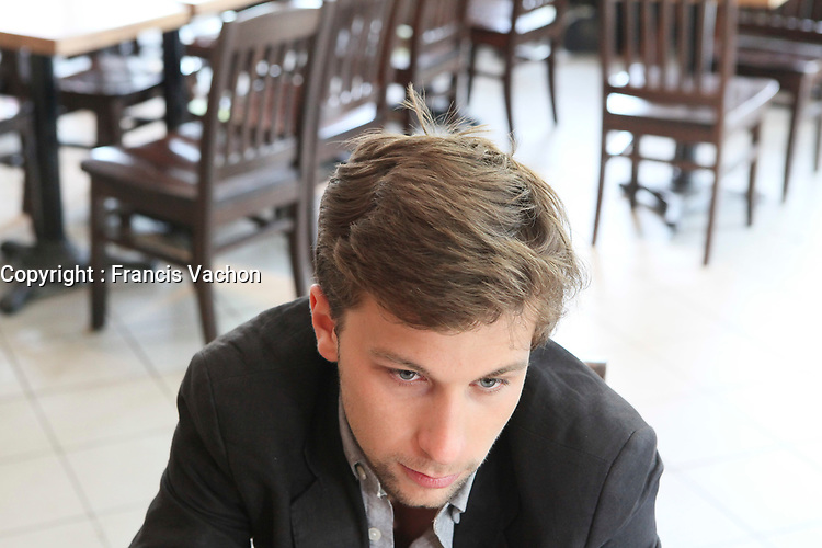 CLASSE spokesperson Gabriel Nadeau Dubois speaks to an AFP reporter in a one-on-one interview before going to a meeting with Quebec education Minister Michelle Courchesne in Quebec City Monday May 28, 2012. The students strike over tuition fee in the province of Quebec is now more than 100 days old and both parties agreed to sit down another time to solve the crisis.<br /> <br /> PHOTO :  Francis Vachon - Agence Quebec Presse