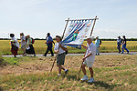 Bradwell on Sea, Essex England. Pilgrimage to St Peters Chapel 2009. Banner is of St Cedd who founded Celtic style community and chapel here is 654AD.
