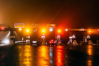 Toll booth on a rainy night.