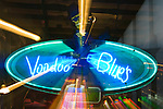 Louisiana, New Orleans, Bourbon Street, Voodoo Blues Neon Sign (Zoom Blur)