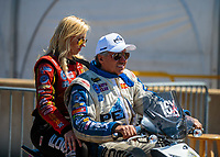 Jun 3, 2018; Joliet, IL, USA; NHRA funny car driver John Force (right) with daughter Courtney Force during the Route 66 Nationals at Route 66 Raceway. Mandatory Credit: Mark J. Rebilas-USA TODAY Sports