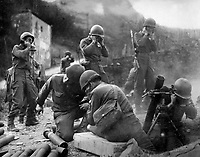 """Getting across the Rhine wasn't all there was to it.  There was the little matter of establishing a beachhead.  We threw our mortars at them and everything else we had untill they finally gave away.""  1945.  Army. (OWI)<br /> Exact Date Shot Unknown<br /> NARA FILE #:  208-YE-133<br /> WAR & CONFLICT BOOK #:  1085"