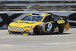 Sprint Cup Series driver Marcos Ambrose (9) in action during the Nascar Sprint Cup Series practice session at Texas Motor Speedway in Fort Worth,Texas.