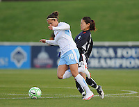 Chicago Red Stars forward Carli Lloyd (10) gets fouled by Washington Freedom midfielder Homare Sawa (10)  Washington Freedom tied Chicago Red Stars 1-1  at The Maryland SoccerPlex, Saturday April 11, 2009.