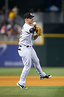 Charlotte Knights third baseman Matt Davidson (22) makes a throw to first base against the Norfolk Tides at BB&T BallPark on April 9, 2015 in Charlotte, North Carolina.  The Knights defeated the Tides 6-3.   (Brian Westerholt/Four Seam Images)
