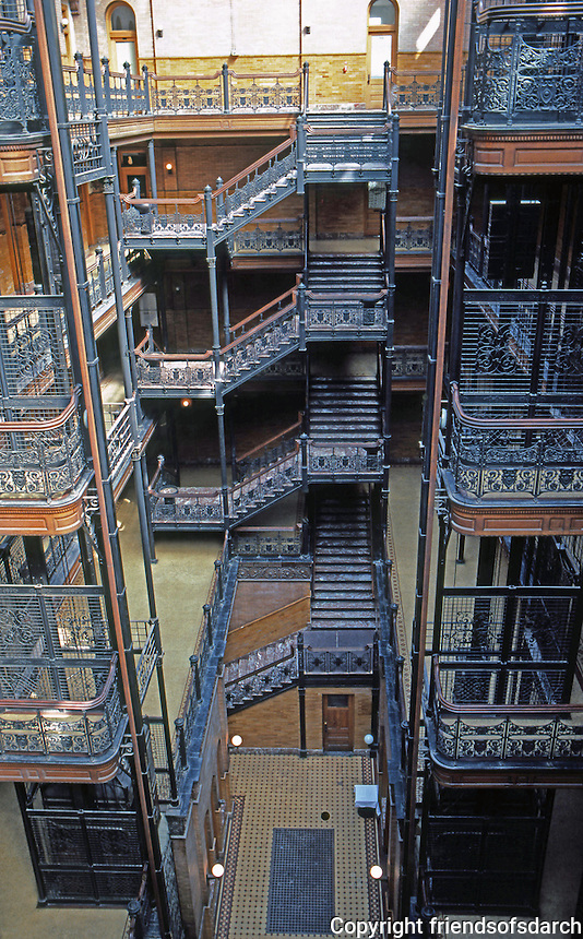 Los Angeles: Bradbury Building. 5 stories with natural light and center courtyard, Geometric patterned staircases with ornately designed wroght-iron rails. Photo '78.