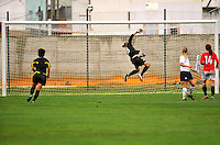 USA keeper Nicole Barnhart makes an acrobatic save. The USA defeated Norway 2-1 at Olhao Stadium on February 26, 2010 at the Algarve Cup.