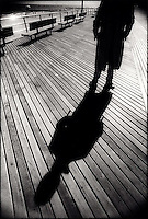 Man's shadow on boardwalk<br />