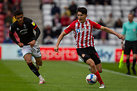 22nd May 2021; Stadium of Light, Sunderland, Tyne and Wear, England; English Football League, Playoff, Sunderland versus Lincoln City; Luke O'Nien of Sunderland watched by Brennan Johnson of Lincoln City