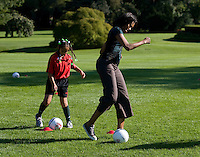 Michelle Obama participates in a drill during a Lets Move! soccer clinic held on the South Lawn of the White House.  Let's Move! was started by Mrs. Obama as a way to promote a healthier lifestyle in children across the country.