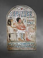 Ancient Egyptian stele of Djehutynefer called Seshu, Scribe, limestone, New Kingdom, 18th Dynasty, (1500-14253 BC), Thebes, Old Fund cat 1638. Egyptian Museum, Turin. Grey background.<br /> <br /> Djehutynefer called Seshu was the accountant scribe of cattle and fowl in the temple of Amon, and his wife the house mistress Benbu