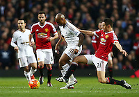 Ander Herrera of Manchester United and Andre Ayew of Swansea City during the Barclays Premier League match between Manchester United and Swansea City played at Old Trafford, Manchester on January 2nd 2016